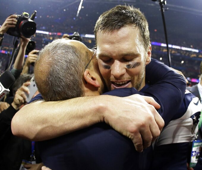 New England Patriots' Tom Brady hugs New England Patriots president Jonathan Kraft, after the NFL Super Bowl 53 football game against the Los Angeles Rams, Sunday, Feb. 3, 2019, in Atlanta. The Patriots won 13-3. (AP Photo/Mark Humphrey)