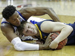 Kansas' David McCormack, left, tries to wrestle the ball away from West Virginia's Logan Routt during the second half of an NCAA college basketball game in the Big 12 men's tournament Friday, March 15, 2019, in Kansas City, Mo. Kansas won 88-74. (AP Photo/Charlie Riedel)