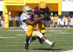 Arizona State wide receiver Kyle Williams (10) is tackled by UCLA safety Adarius Pickett after a catch during the first half of an NCAA college football game, Saturday, Nov. 10, 2018, in Tempe, Ariz. (AP Photo/Ralph Freso)