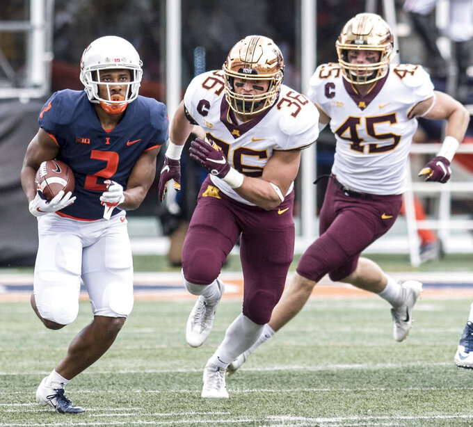 Illinois running back Reggie Corbin (2) runs the ball as Minnesota's Blake Cashman (36)and Carter Coughlin (45) pursue  in the first half of an NCAA  college football game, Saturday, Nov. 3, 2018, in Champaign, Ill. (AP Photo/Holly Hart)