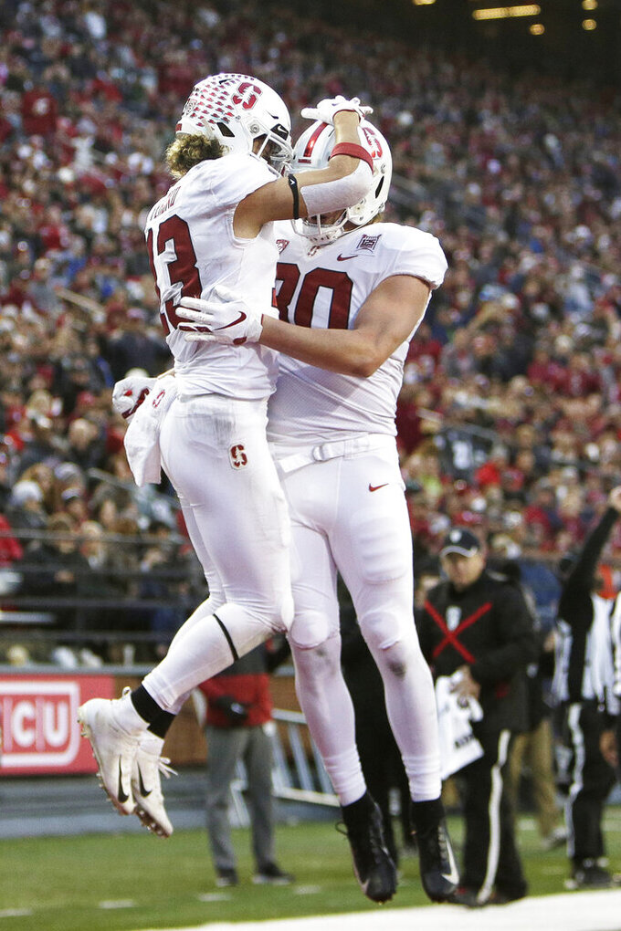 Stanford wide receiver Simi Fehoko, left, celebrates his touchdown with tight end Scooter Harrington during the second half of an NCAA college football game against Washington State in Pullman, Wash., Saturday, Nov. 16, 2019. Washington State won 49-22. (AP Photo/Young Kwak)