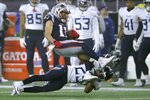Tennessee Titans cornerback Adoree' Jackson, below, tackles New England Patriots wide receiver Julian Edelman in the first half of an NFL wild-card playoff football game, Saturday, Jan. 4, 2020, in Foxborough, Mass. (AP Photo/Charles Krupa)