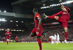 Liverpool's Sadio Mane, center, celebrates with Liverpool's Roberto Firmino after scoring his side's second goal during the English Premier League soccer match between Liverpool and Sheffield United at Anfield Stadium, Liverpool, England, Thursday, Jan. 2, 2020. (AP Photo/Jon Super)