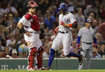 Texas Rangers' Hunter Pence, right, crosses home plate in front of Boston Red Sox catcher Christian Vazquez, left, while scoring on his inside the park home run in the sixth inning of a baseball game at Fenway Park in Boston, Tuesday, June 11, 2019. (AP Photo/Charles Krupa)