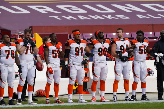 Members of the Cincinnati Bengals on the sidelines before the start of the first half of an NFL football game against the Washington Football Team, Sunday, Nov. 22, 2020, in Landover. (AP Photo/Susan Walsh)