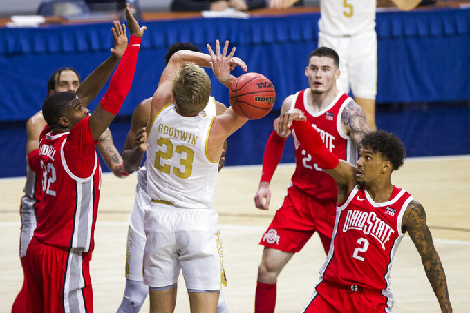 Ohio State's E.J. Liddell (32) and Musa Jallow (2) work together to knock the ball away from Notre Dame's Dane Goodwin (23) during the first half of an NCAA college basketball game Tuesday, Dec. 8, 2020, in South Bend, Ind. (AP Photo/Robert Franklin)