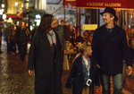 This image released by IFC Films shows, from left, Juliette Binoche, Clémentine Grenier and Ethan Hawke in a scene from