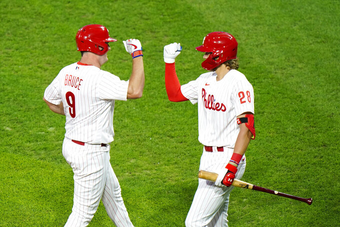 Philadelphia Phillies' Jay Bruce, left, and Alec Bohm celebrate after Bruce's home run off Washington Nationals pitcher Erick Fedde during the second inning of a baseball game, Monday, Aug. 31, 2020, in Philadelphia. (AP Photo/Matt Slocum)