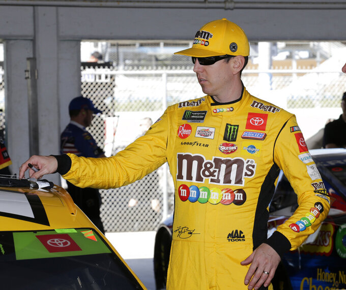 Kyle Busch prepares to practice for a NASCAR Cup Series auto race on Saturday, Nov. 16, 2019, at Homestead-Miami Speedway in Homestead, Fla. Busch is one of four drivers racing for the championship. (AP Photo/Terry Renna)