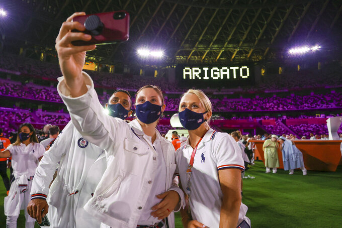 Athletes of the United States pose during the closing ceremony in the Olympic Stadium at the 2020 Summer Olympics, Sunday, Aug. 8, 2021, in Tokyo, Japan. (Dan Mullen/Pool Photo via AP))