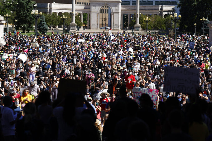 Demonstrators crowd into Civic Center Park during a rally calling for more oversight of the police Sunday, June 7, 2020, in Denver. Demonstrators marched from the park, which is in the heart of downtown, east along Colfax Avenue to City Park after the rally. (AP Photo/David Zalubowski)