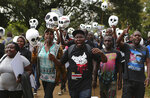 South Sudanese and Kenyan activists, some carrying mock skulls, protest against South Sudanese officials allegedly benefiting from the civil war and laundering money through Kenyan banks, in downtown Nairobi, Kenya Thursday, Oct. 11, 2018. Activists and refugees pressured Kenya's government to act against South Sudanese officials who have been sanctioned by the United Nations and are thought to be living freely in Kenya. (AP Photo/Brian Inganga)