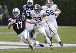 Virginia linebacker Zane Zandier (33) and defensive tackle Eli Hanback (58) chase Duke quarterback Daniel Jones (17) during the first half of an NCAA college football game in Durham, N.C., Saturday, Oct. 20, 2018. (AP Photo/Gerry Broome)