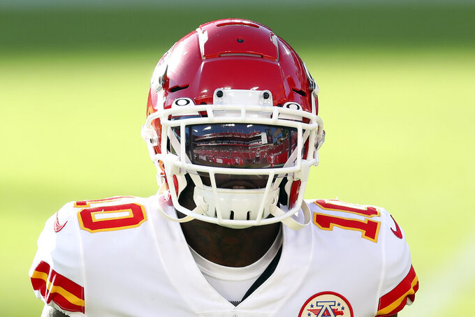 Raymond James Stadium is reflected in Kansas City Chiefs wide receiver Tyreek Hill's visor before an NFL football game against the Tampa Bay Buccaneers Sunday, Nov. 29, 2020, in Tampa, Fla. (AP Photo/Mark LoMoglio)