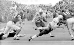FILE - In this Nov. 25, 1971, file photo, Nebraska's Jeff Kinney (35) gets a block from fullback Maury Damkroger (46) as he scores against Oklahoma from the two-yard line with 1:38 left in a college football game in Norman, Okla., on Thanksgiving Day. The game on Thanksgiving 50 years ago is back in the spotlight as Nebraska and Oklahoma renew their rivalry on Saturday, Sept. 18, 2021. (Tulsa World via AP, File)