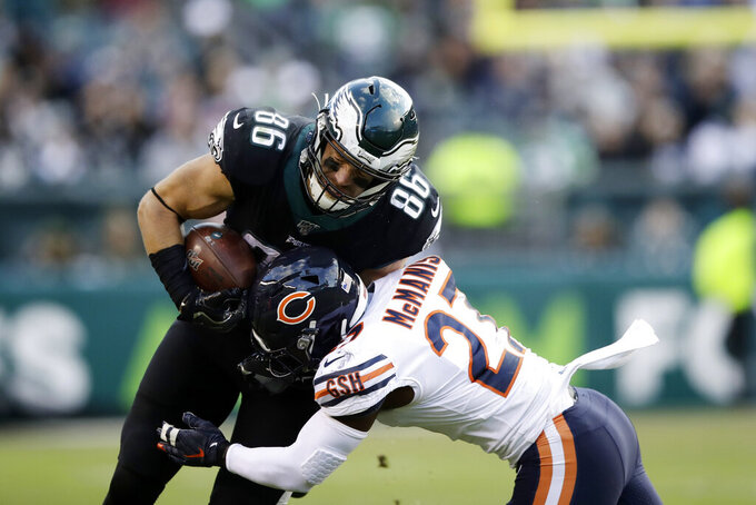 Philadelphia Eagles' Zach Ertz, left, is tackled by Chicago Bears' Sherrick McManis during the second half of an NFL football game, Sunday, Nov. 3, 2019, in Philadelphia. (AP Photo/Matt Rourke)