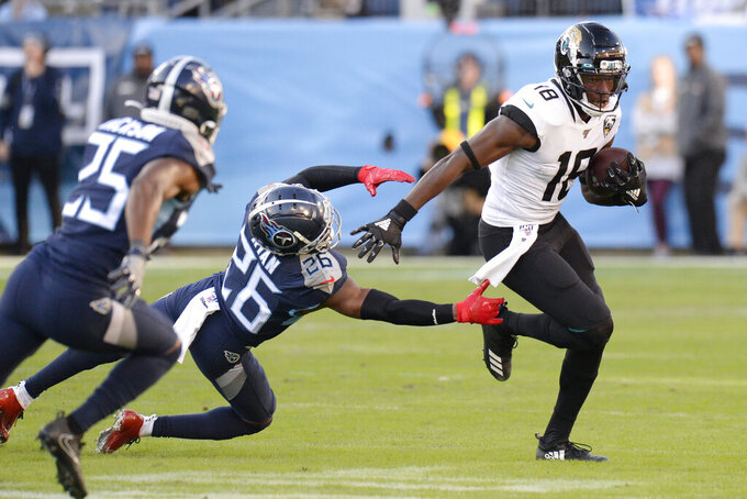 Jacksonville Jaguars wide receiver Chris Conley (18) gets past Tennessee Titans cornerback Logan Ryan (26) in the first half of an NFL football game Sunday, Nov. 24, 2019, in Nashville, Tenn. (AP Photo/Mark Zaleski)