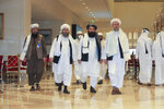 FILE - In this Thursday, Aug. 12, 2021 file photo, the Taliban delegation arrives for Afghan peace talks in Doha, Qatar. (AP Photo/Hussein Sayed)