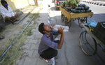 A vendor drinks water on a summer day in Jammu, India, Tuesday, May 26, 2020. Many northern cities in India are reeling under an intense heat wave with the temperatures on Wednesday crossing a scorching 45 degrees Celsius (113 degrees Fahrenheit).  (AP Photo/Channi Anand)