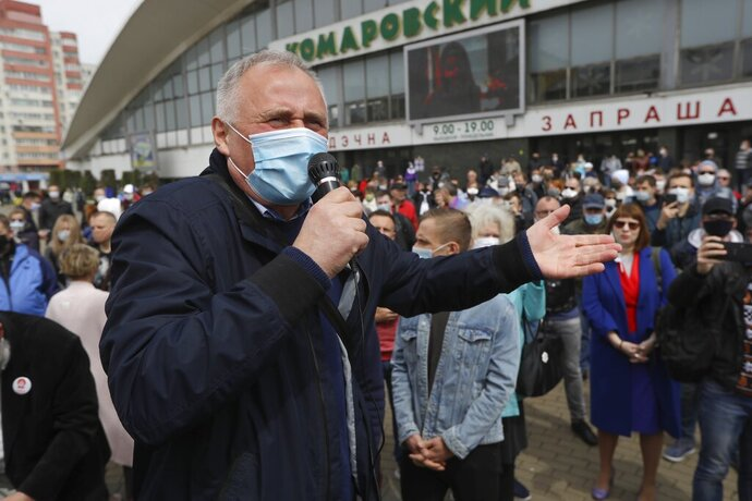 FILE - In this file photo taken on Sunday, May 24, 2020, an opposition activist Nikolai Statkevich, wearing a face mask to protect against coronavirus, gestures as he speaks to people gathered to sign up and support potential presidential candidates in the upcoming presidential elections in Minsk, Belarus. On Sunday, Nikolai Statkevich, one of Belarus' most prominent opposition figures, was detained while heading for a protest in Minsk. (AP Photo/Sergei Grits, File)