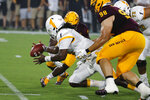 Kent State quarterback Woody Barrett, center, recovers his own fumble in front of Arizona State linebacker Darien Butler (37) and defensive lineman D.J. Davidson (98) during the first half of an NCAA college football game Thursday, Aug. 29, 2019, in Tempe, Ariz. (AP Photo/Ralph Freso)