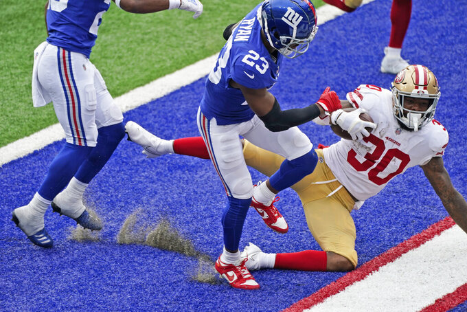 San Francisco 49ers' Jeff Wilson (30) scores a touchdown during the second half of an NFL football game against the New York Giants, Sunday, Sept. 27, 2020, in East Rutherford, N.J. (AP Photo/Corey Sipkin)