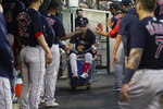 Boston Red Sox's Enrique Hernandez is pushed in a cart in the dugout after hitting a two-run home run against the Detroit Tigers in the fifth inning of a baseball game in Detroit, Wednesday, Aug. 4, 2021. (AP Photo/Paul Sancya)