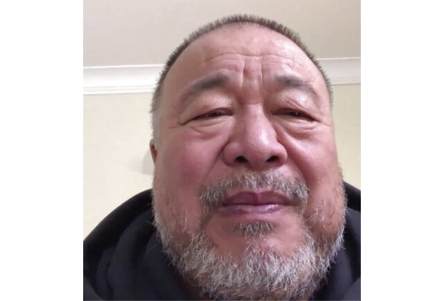 In this image made from a Skype video interview with Chinese artist dissident Ai Weiwei comments on the recent security law planned for Hong kong from a location in Cambridge, England, Wednesday, May 27, 2020. Ai Weiwei believes the newly passed national security law for Hong Kong augurs the end for the semi-autonomous city. (AP Photo/Park Juwon)