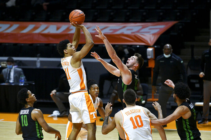 Tennessee's Jaden Springer (11) shoots against South Carolina-Upstate during an NCAA college basketball game Wednesday, Dec. 23, 2020, in Knoxville, Tenn. (Saul Young/Knoxville News Sentinel via AP, Pool)