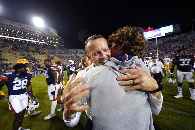 Auburn head coach Bryan Harsin hugs his son Davis Harsin after defeating LSU in an NCAA college football game in Baton Rouge, La., Saturday, Oct. 2, 2021. Auburn won 24-19. (AP Photo/Gerald Herbert)