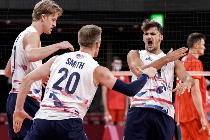 United States' Torey Defalco, right, reacts during the men's volleyball preliminary round pool B match between United States and Russian Olympic Committee at the 2020 Summer Olympics, Monday, July 26, 2021, in Tokyo, Japan. (AP Photo/Manu Fernandez)