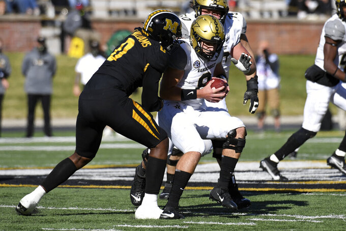 Vanderbilt quarterback Ken Seals, right, is pulled down by Missouri linebacker Tre Williams (0) during the first half of an NCAA college football game Saturday, Nov. 28, 2020, in Columbia, Mo. (AP Photo/L.G. Patterson)