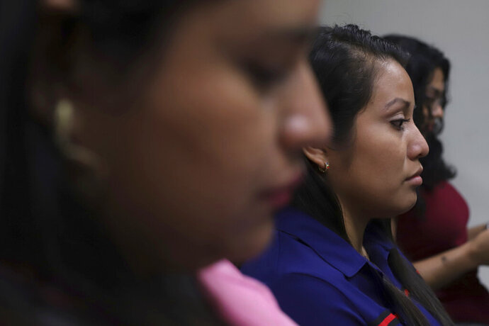FILE - In this July 15, 2019 file photo, Evelyn Beatriz Hernandez sits in court, after her 30-year sentence for murder was overturned in February, in Ciudad Delgado on the outskirts of San Salvador, El Salvador. Hernandez is, on Thursday, Aug. 15, being tried again for the same crime. (AP Photo/Salvador Melendez, File)