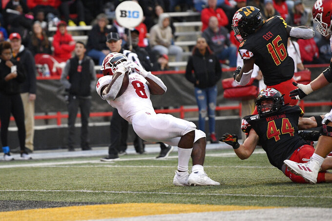 Indiana running back Stevie Scott III (8) carries the ball en route to scoring a touchdown past Maryland linebacker Chance Campbell (44) and linebacker Ayinde Eley (16) during the second half of an NCAA football game, Saturday, Oct. 19, 2019, in College Park, Md. (AP Photo/Nick Wass)