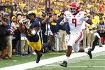 Michigan wide receiver Donovan Peoples-Jones (9) lies out to catch a pass as Rutgers linebacker Tyreek Maddox-Williams (9) defends in the second half of an NCAA college football game in Ann Arbor, Mich., Saturday, Sept. 28, 2019. The pass was incomplete when Peoples-Jones landed out of bounds. (AP Photo/Paul Sancya)