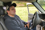 In this photo taken Sept. 20, 2019, rancher Jerome Rosa, who is executive director of the Oregon Cattlemen's Association, sits in his pickup truck during an interview in Marquam, Ore.  The Trump administration's trade war is affecting Oregon's agricultural exports more than most states because 40% of the state's agriculture production is sent abroad. That's compared to 20% for the rest of the U.S. The heads of the associations representing Oregon's wheat and hazelnut farmers and cattle ranchers recently joined the director of the state agriculture department to describe the toll to state lawmakers. They say sales of beef and wheat to China have halted.  (AP Photo/Andrew Selsky)