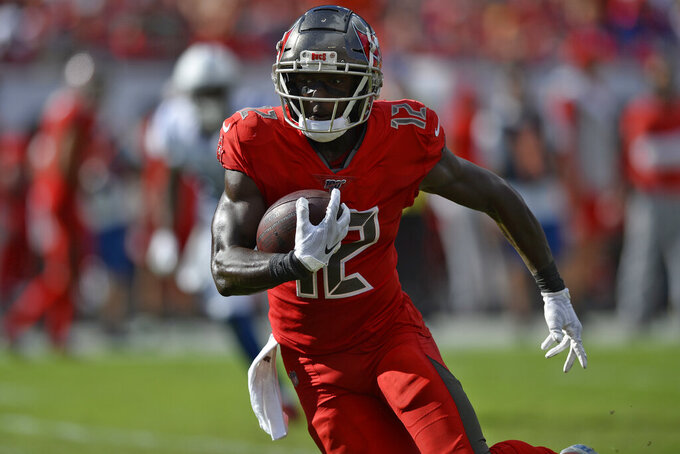 Tampa Bay Buccaneers wide receiver Chris Godwin (12) runs with the football after a reception against the Indianapolis Colts during the first half of an NFL football game Sunday, Dec. 8, 2019, in Tampa, Fla. (AP Photo/Jason Behnken)