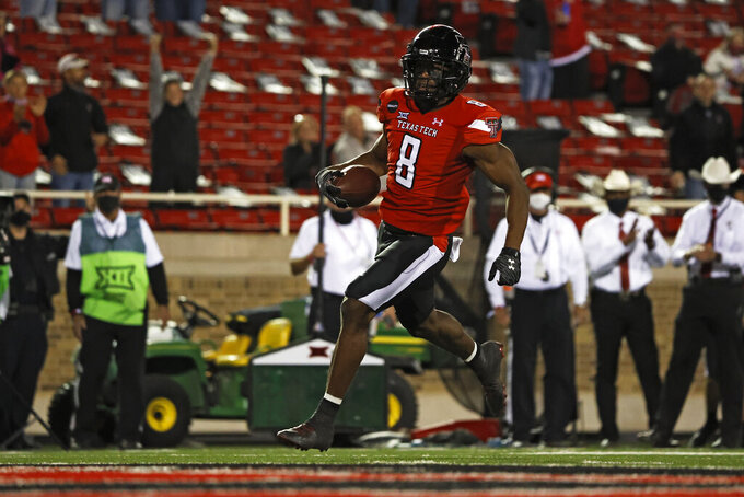 Texas Tech's Zech McPhearson (8) scores a touchdown on a fumble recovery during the second half of an NCAA college football game against West Virginia, Saturday, Oct. 24, 2020, in Lubbock, Texas. (AP Photo/Brad Tollefson)