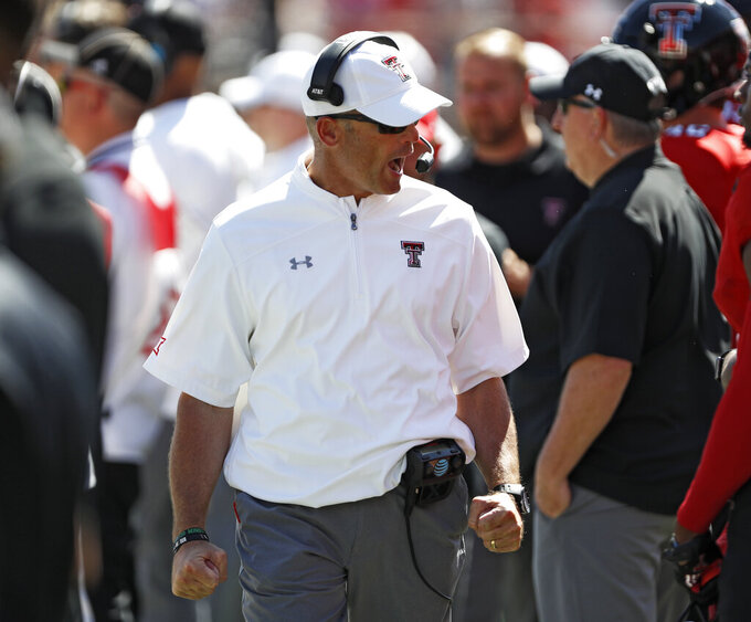 Texas Tech coach Matt Wells yells to his players during the second half of an NCAA college football game against Oklahoma State, Saturday, Oct. 5, 2019, in Lubbock, Texas. (AP Photo/Brad Tollefson)
