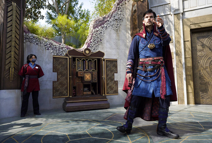 """A Doctor Strange character performs during the """"Doctor Strange: Mysteries of the Mystic Arts"""" show at the Avengers Campus media preview at Disney's California Adventure Park on Wednesday, June 2, 2021, in Anaheim, Calif. (AP Photo/Chris Pizzello)"""