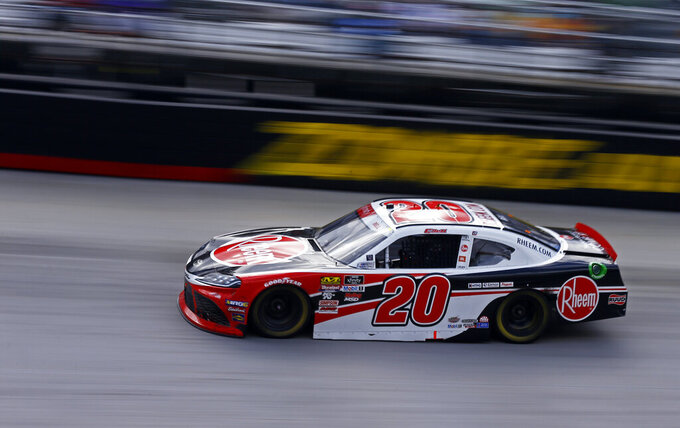 Driver Christopher Bell (20) makes his way through turn 4 during an NASCAR Xfinity Series auto race on Saturday, April 6, 2019, in Bristol, Tenn. (AP Photo/Wade Payne)