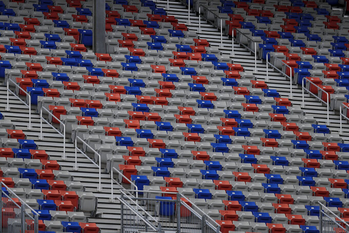 Empty stands are viewed during a NASCAR Cup Series auto race at Atlanta Motor Speedway, Sunday, June 7, 2020, in Hampton, Ga. (AP Photo/Brynn Anderson)