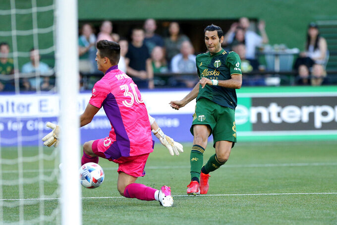 Portland Timbers midfielder Diego Valeri scores his 100th MLS goal, against Los Angeles FC goalie Tomás Romero during the first half of an MLS soccer match Wednesday, July 21, 2021, in Portland, Ore. (Sean Meagher/The Oregonian via AP)