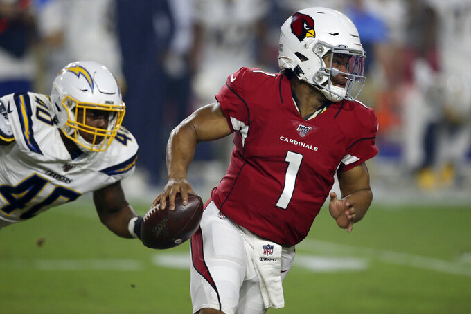 Arizona Cardinals quarterback Kyler Murray (1) tries to elude Los Angeles Chargers linebacker Chris Peace (40) during the first half of an NFL preseason football game, Thursday, Aug. 8, 2019, in Glendale, Ariz. (AP Photo/Ross D. Franklin)