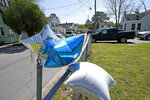 FILE - In this April 22, 2021 file photo, balloons are seen tied to a fence in Elizabeth City, N.C. The fatal shooting of a Black man by sheriff's deputies has sent shock waves through Elizabeth City. The majority Black city in the state's rural northeastern corner holds an important place in African American history in the 19th and 20th centuries. But some residents say it seemed too close-knit and too out-of-the-way to become a flashpoint in the 21st.  (AP Photo/Gerry Broome, File)