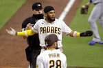 San Diego Padres' Fernando Tatis Jr. reacts after being tagged out while trying to score from third base off a line out by Manny Machado during the seventh inning of a baseball game against the Los Angeles Dodgers, Monday, Aug. 3, 2020, in San Diego. (AP Photo/Gregory Bull)