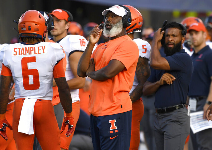 Illinois head coach Lovie Smith, center, looks up at the scoreboard during the second half of an NCAA college football game, Saturday, Sept. 7, 2019, in East Hartford, Conn. (AP Photo/Jessica Hill)