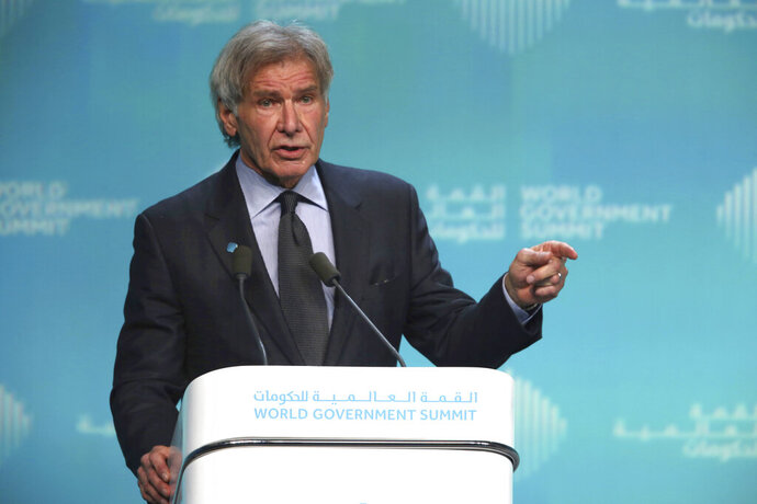 American actor Harrison Ford speaks about ocean conservation at the World Government Summit in Dubai, United Arab Emirates, Tuesday, Feb. 12, 2019. Ford offered an emphatic plea for protecting the world's oceans while calling out U.S. President Donald Trump and others who