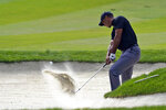 Tiger Woods hits from the bunker off the 13th fairway during the first round of the Zozo Championship golf tournament Thursday, Oct. 22, 2020, in Thousand Oaks, Calif. (AP Photo/Marcio Jose Sanchez)