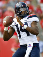Arizona quarterback Khalil Tate drops back to pass during the first half of an NCAA college football game against Houston, Saturday, Sept. 8, 2018, in Houston. (AP Photo/Eric Christian Smith)